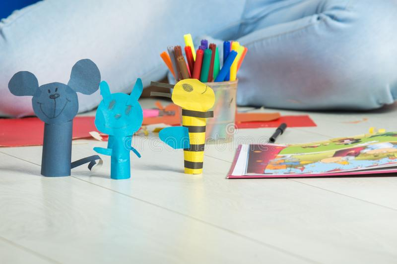 Crafts animal figurines made of colored paper. Crafts of animal figurines made of colored paper stock photography