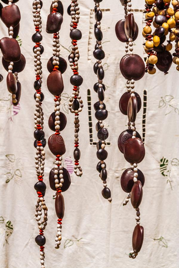 Crafts embroidered tablecloths and necklaces seed. In Nosy Komba & x28;Nosy Be& x29;, Madagascar royalty free stock images