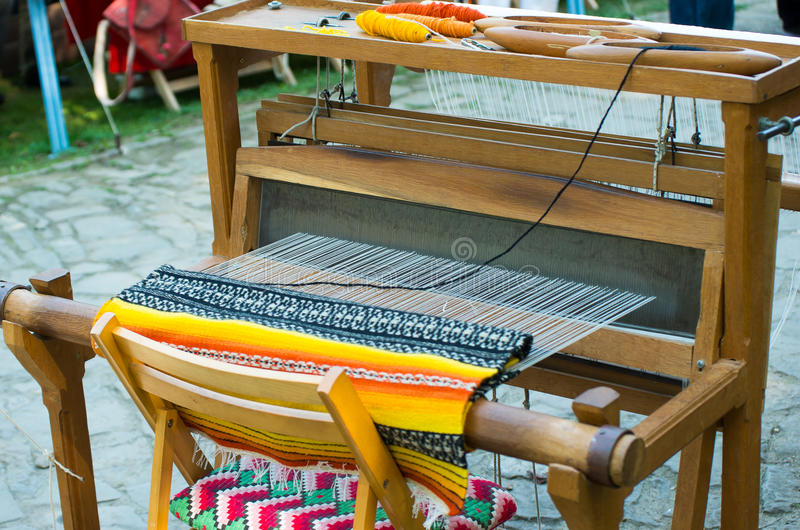 Crafts. Hand loom. Crafts. Hand loom with many colorful woolen threads stock image