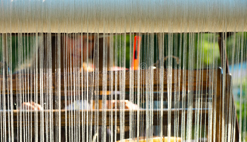 Crafts. Hand loom. Weaver in the background stock image