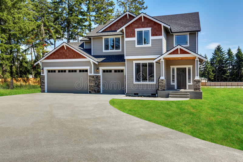 Craftsman American house with rocks trim, garage and concrete floor porch stock images