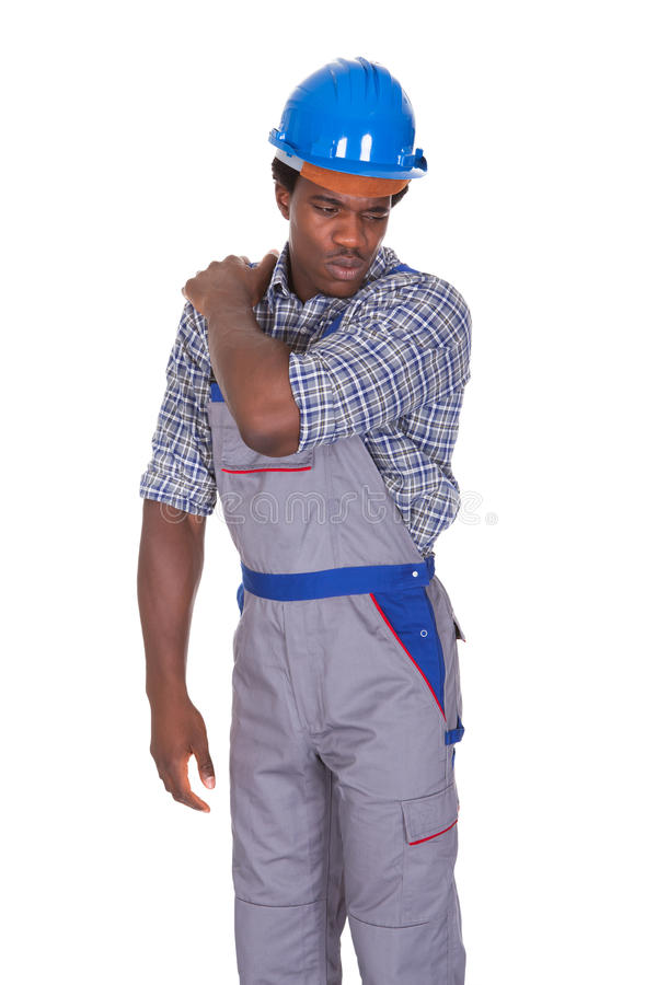 Craftsman with back pain stock image