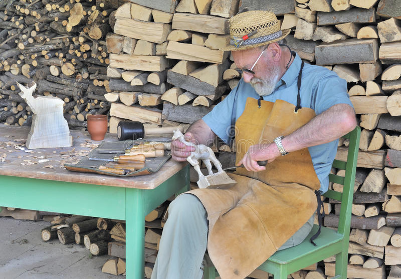 Download Craftsman Carving Wooden Animals Stock Image - Image of craftsman, carving: 21354221