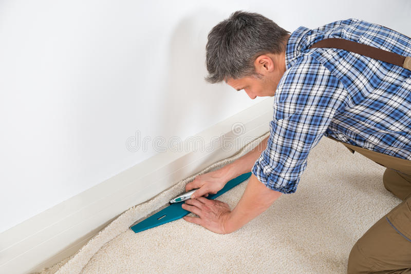 Craftsman fitting carpet stock photography