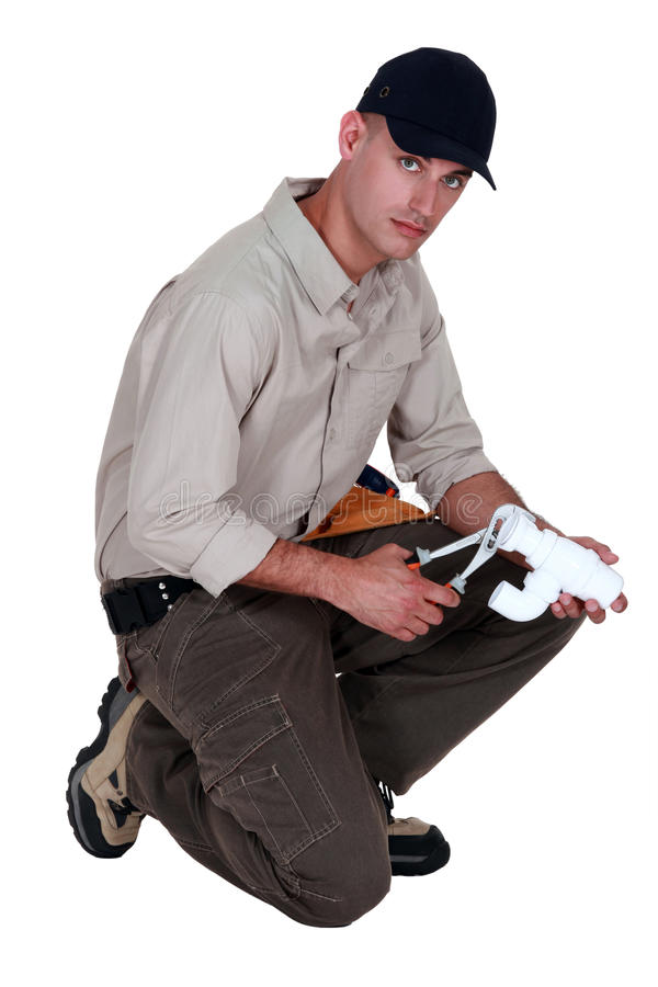Craftsman Fixing A Pipe Royalty Free Stock Images