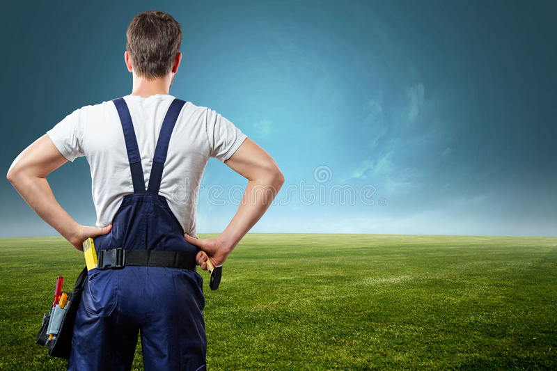 Craftsman. On a green meadow royalty free stock photos