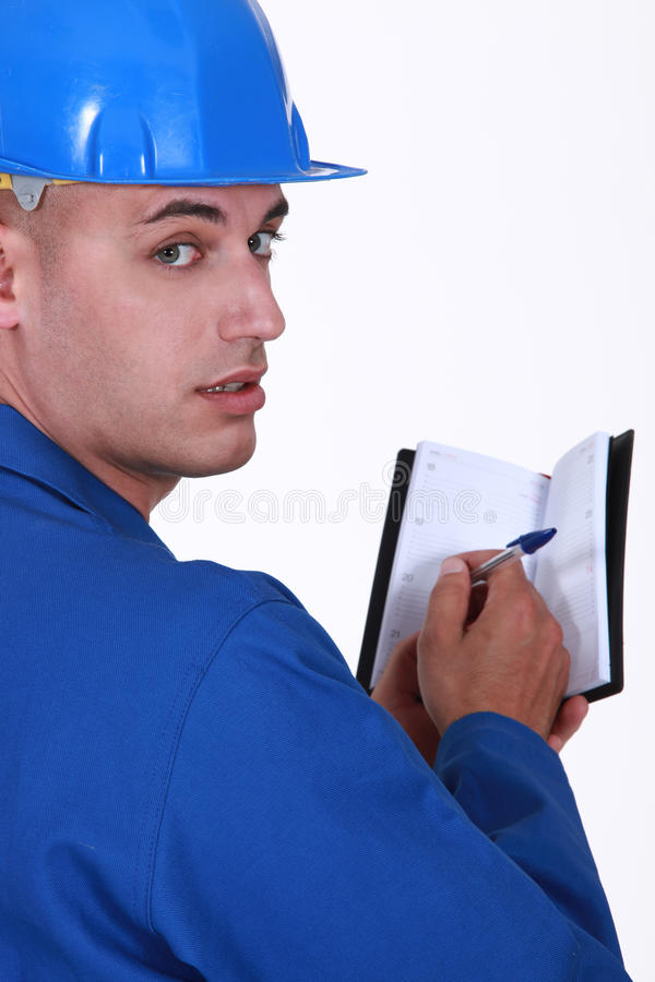 Craftsman holding an agenda royalty free stock images