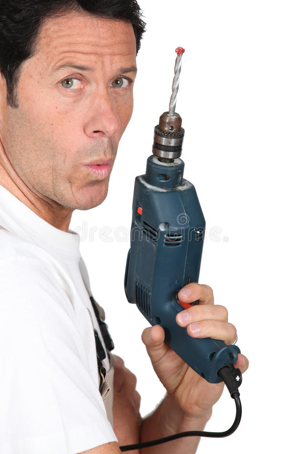 Download Craftsman holding a drill stock photo. Image of hand - 25752370