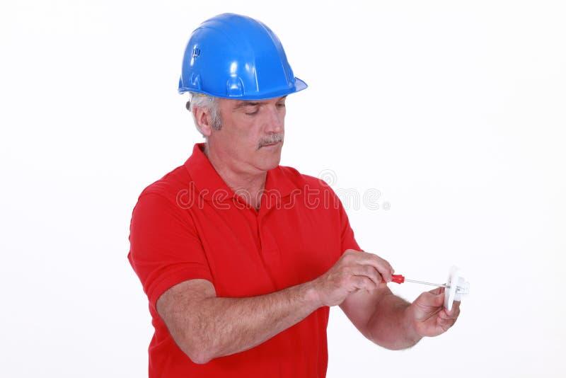 Download Craftsman Holding A Screwdriver Stock Photo - Image of senior, screwdriver: 30483252