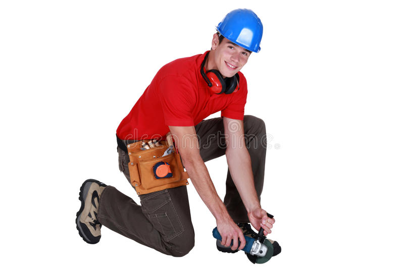 Download Craftsman kneeling down stock photo. Image of blue, isolated - 31992494