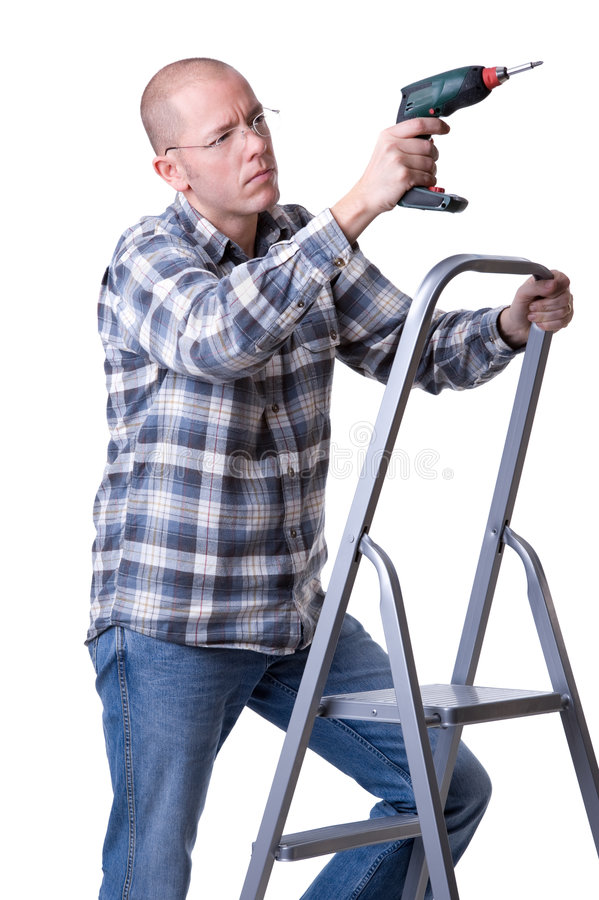 Craftsman on a ladder with a cordless screwdriver. Full isolated studio picture from a young craftsman on a ladder with a cordless screwdriver royalty free stock image