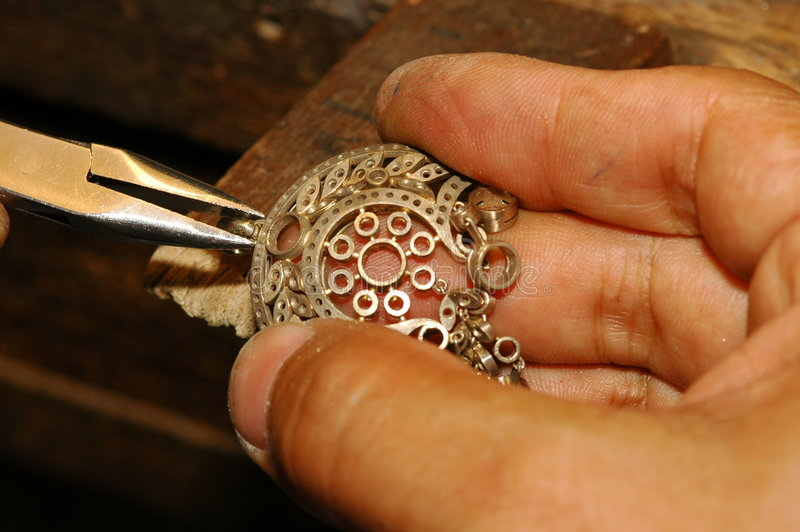 Craftsman making gold jewelry royalty free stock images