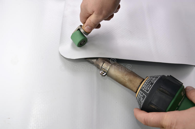 Craftsman making a pre-weld. Blending the two sheets together stock photo