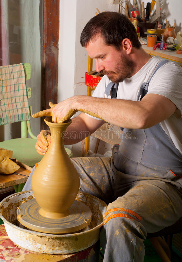 Download Craftsman Making Vase From Fresh Wet Clay Stock Image - Image of wheel, trousers: 23934571