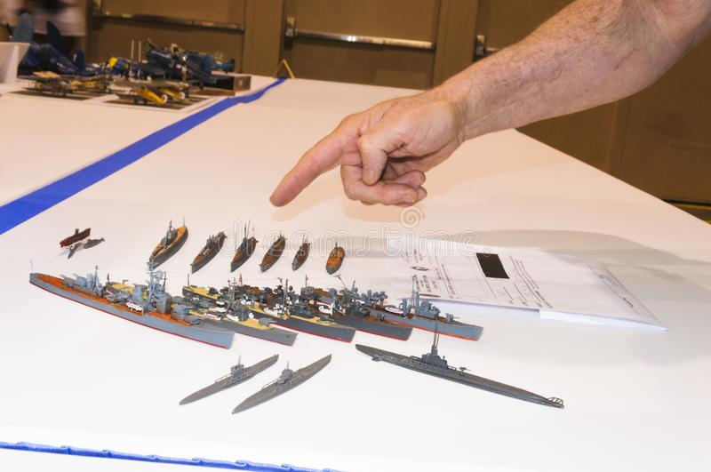 Miniature ship models displayed at the Modeling Convention in Phoenix, Arizona. Craftsman points to Miniature ship models which are displayed at the display stock photos