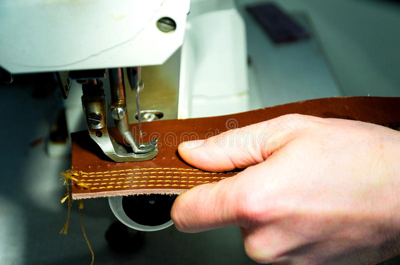 Craftsman sewing machine hand leather royalty free stock image