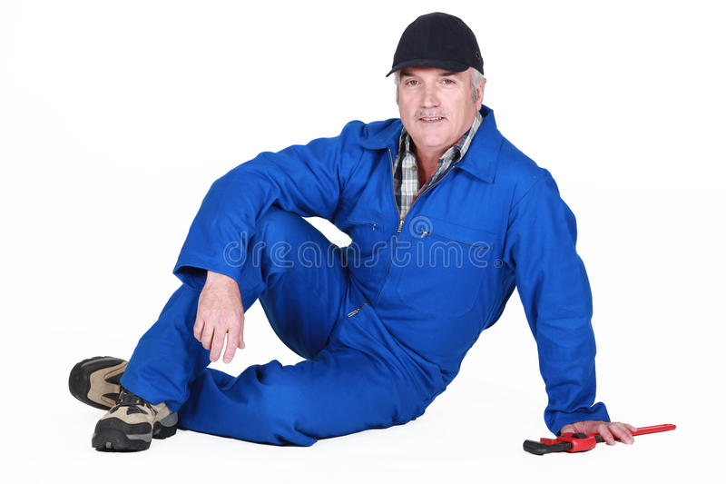 Download Craftsman Sitting On The Floor Stock Photo - Image: 32238878