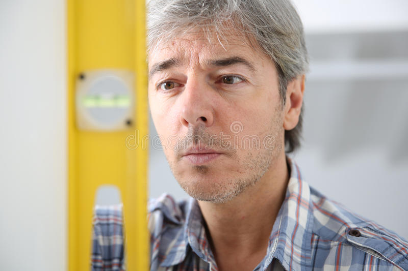 Craftsman using level working on home improvement royalty free stock photography