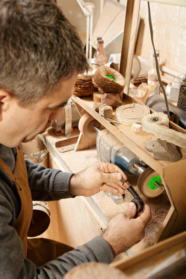 Craftsman working on grinder