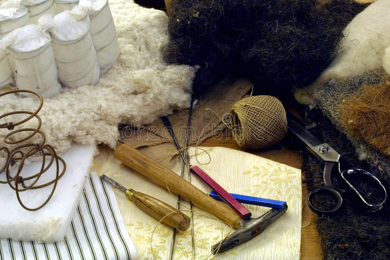 Upholstery. Craftsmans tools and materials for bed upholstery royalty free stock image