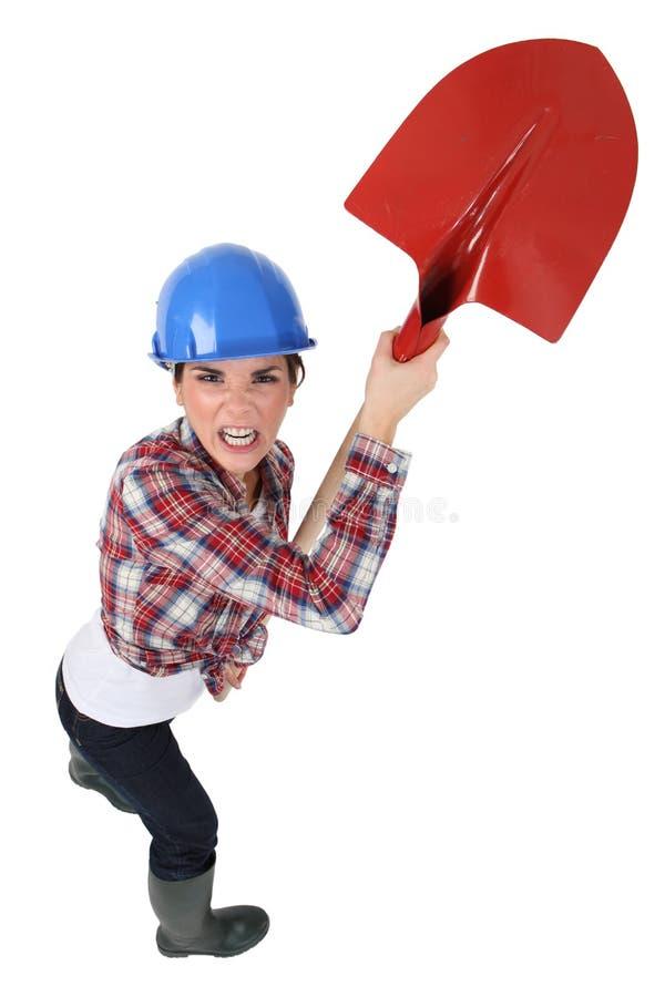 Craftswoman держа лопаткоулавливатель стоковые фото