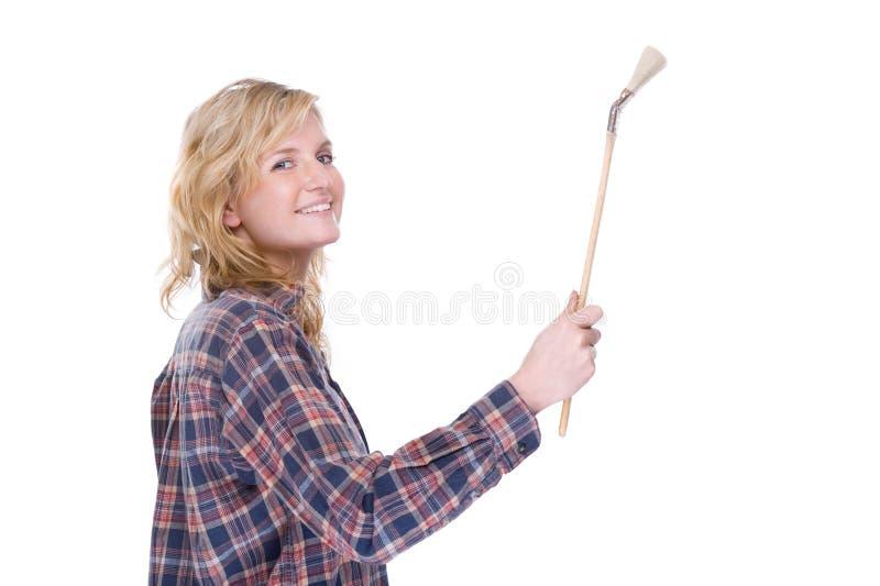 Craftswoman con la spazzola fotografie stock
