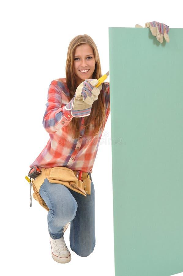 Craftswoman processed gypsum wallboard stock photo