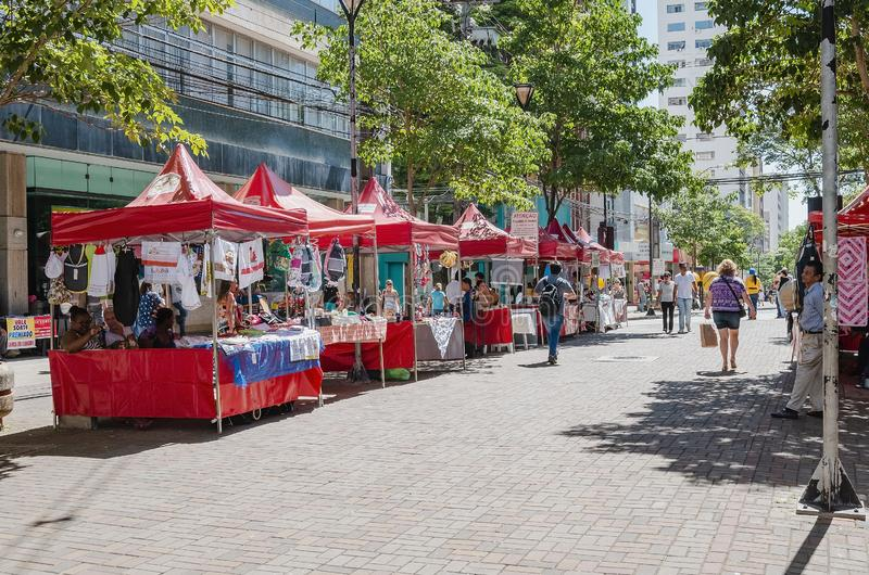 Craftwork being sold on red tents - Londrina. Londrina - PR, Brazil - December 12, 2018: Craftwork being sold on red tents on downtown calçadão de Londrina royalty free stock photo