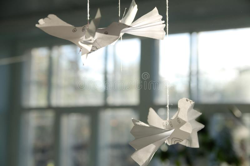 Craftwork paper birds on fiber at home. Peace concept royalty free stock photos