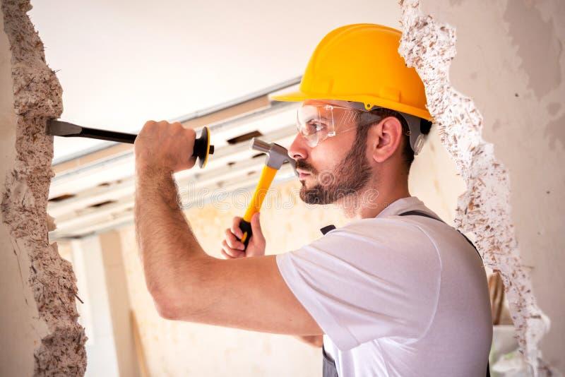 Crafty handyman wearing yellow helmet stock photography