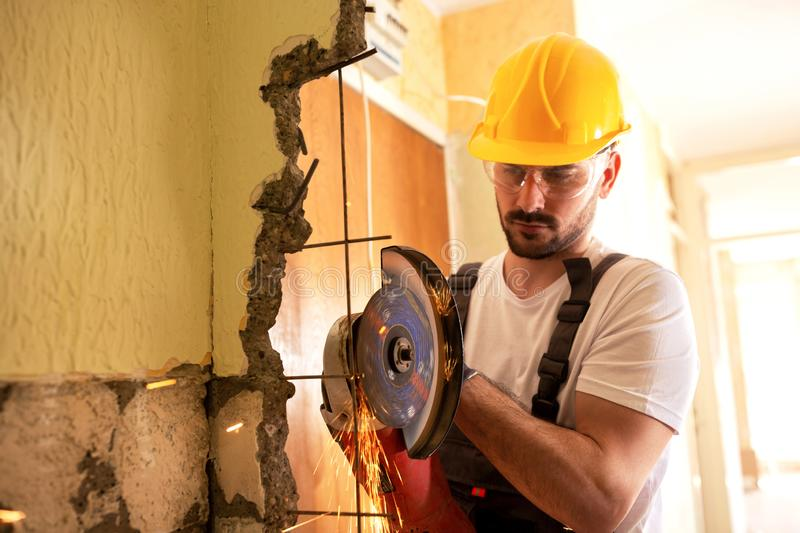 Crafty worker cutting metal fittings royalty free stock image
