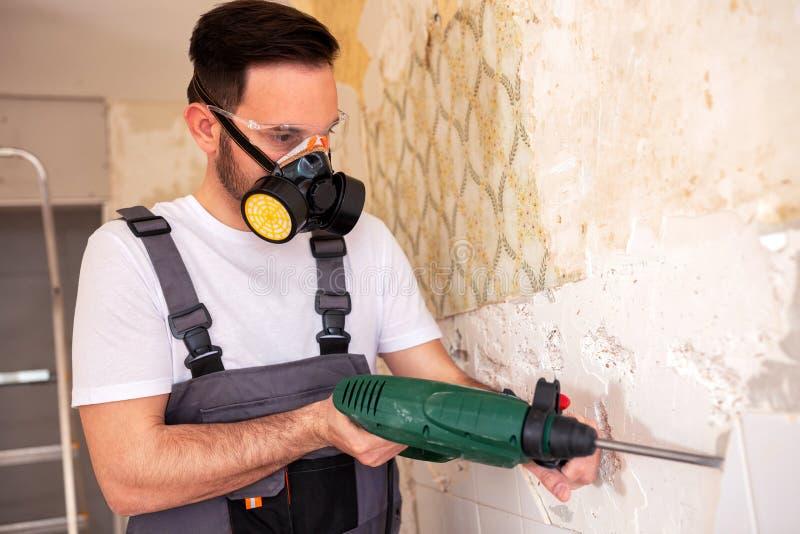 Crafty worker removing porcelain tiles stock image