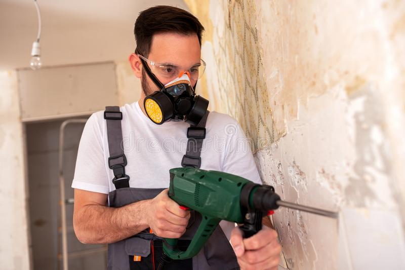 Crafty worker removing porcelain tiles royalty free stock image