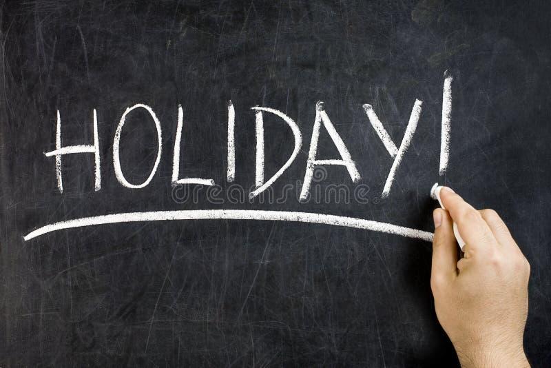 Craie de main de tableau noir de Word de vacances photo stock