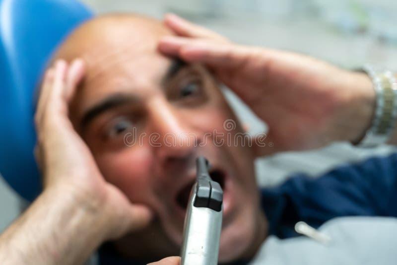 Crainte des dentistes photo stock