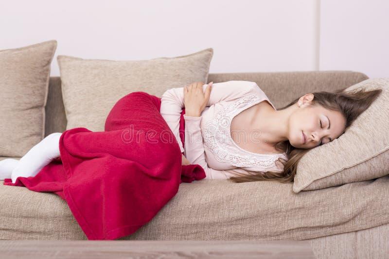 Crampes menstruelles images libres de droits