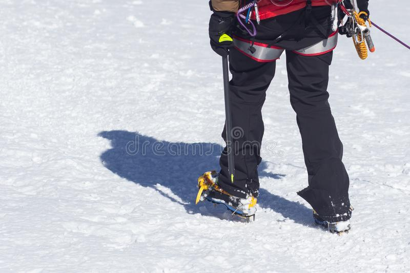 Crampons for ice climbing mounted on Hanwag Omega mountaineering boots. Crampons for ice climbing mounted on mountaineering boots royalty free stock photo