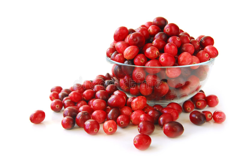 Cranberries in a bowl. Fresh red cranberries in a glass bowl on white background royalty free stock photography