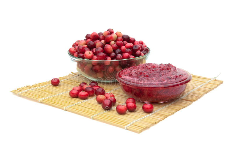 Cranberries and cranberry jam on a white background. royalty free stock photo