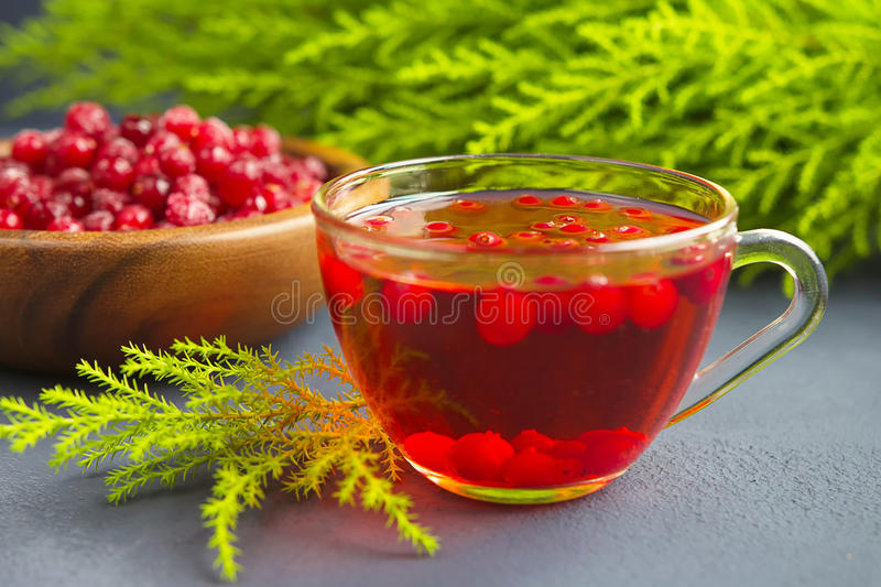 Cranberries and cranberry juice on a dark background stock photos
