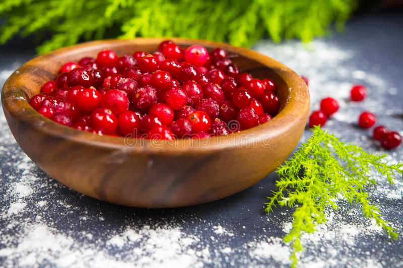 Cranberries and cranberry juice on a dark background stock photo