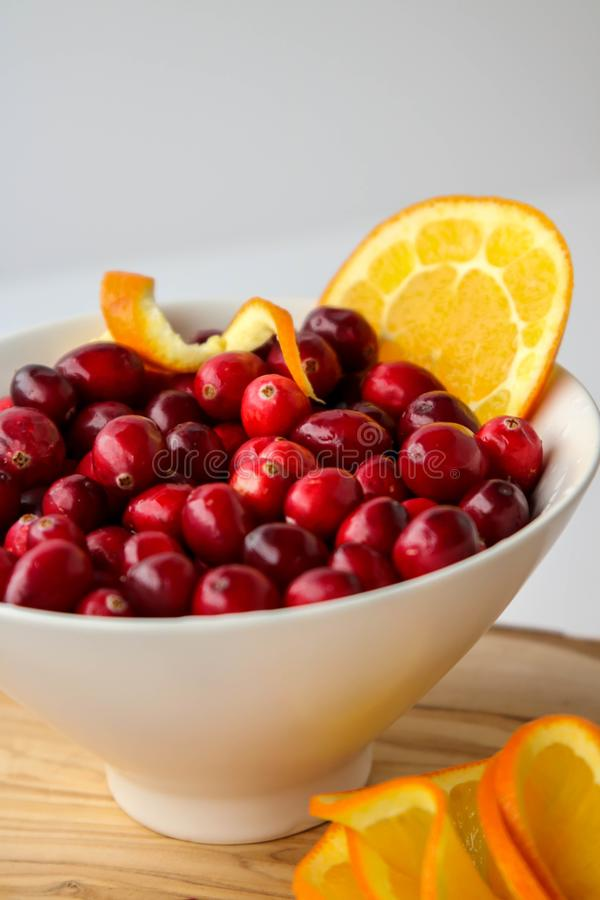 Cranberries and juicy orange slices royalty free stock photos