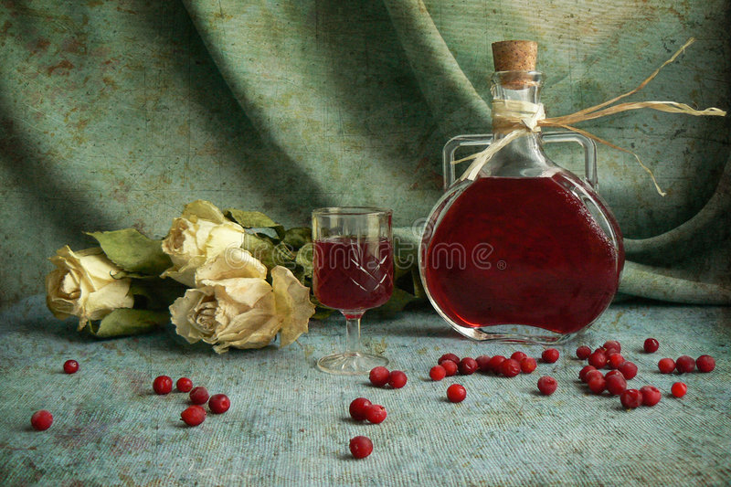 Cranberry. Liqueur with berries and roses stock photos