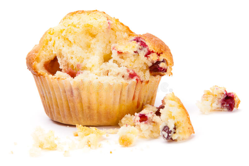 Cranberry muffin on a white background broken royalty free stock photo