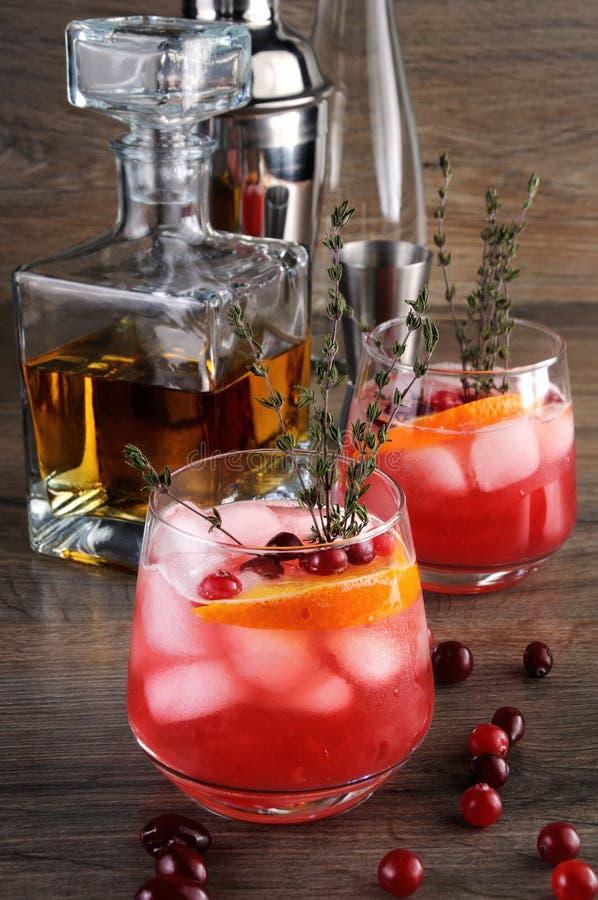Cranberry Orange Bourbon Smash. Cocktail Cranberry Orange Bourbon Smash with a spicy hint of thyme stock photos
