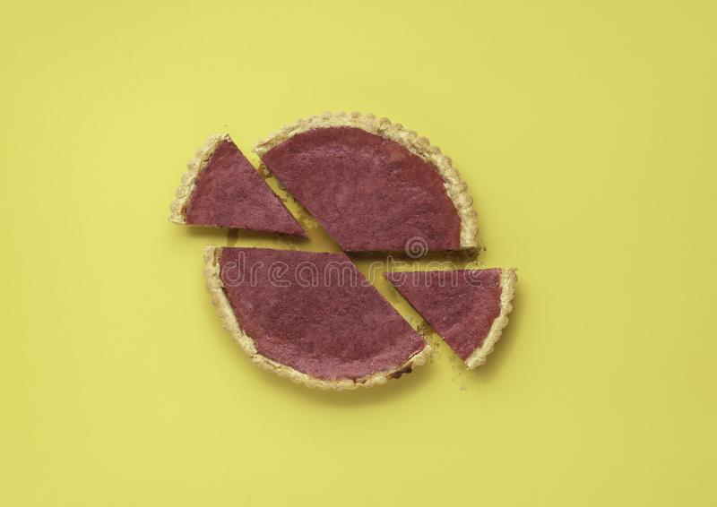 Cranberry pie and two sliced pie portions. Homemade berries tart royalty free stock images