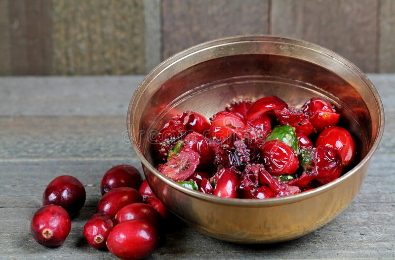 Cranberry relish. In a copperware container stock image