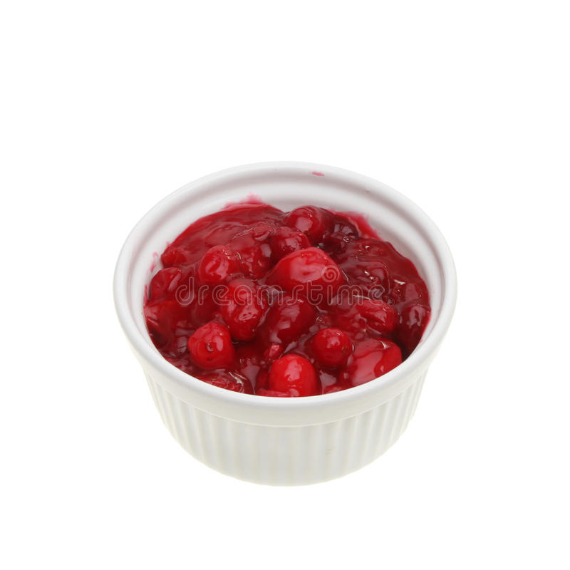 Cranberry sauce. Fresh homemade cranberry sauce in a ramekin isolated against white royalty free stock images
