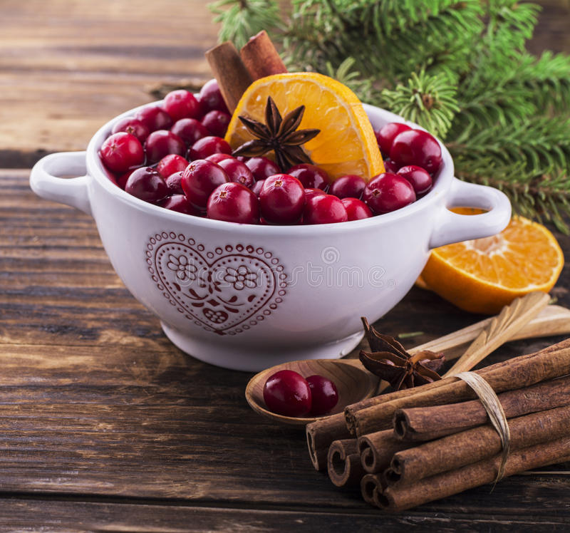Cranberry sauce in ceramic saucepan on dark royalty free stock photography