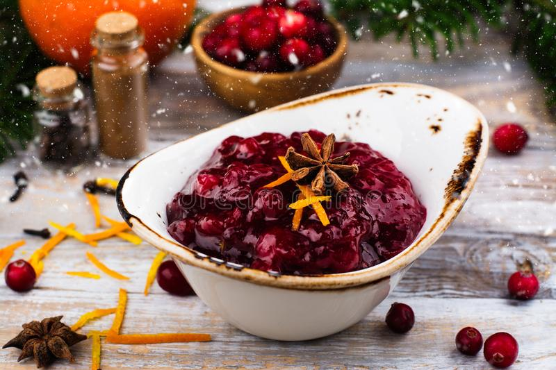 Cranberry sauce with ingredients on wooden table stock photography